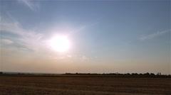 Sunset twilight rural field landscape 4k time-lapse video. Sun sky evening Stock Footage