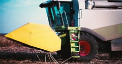 Harvester combine with farmer in cabin 2k slow motion video. Farm machine Stock Footage