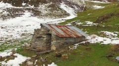 Aerial view of a stone hut in the mountain. Stock Footage