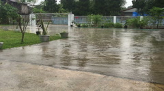 Rain falling on the concrete floor outside the house Thailand, real time Stock Footage