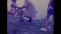1966: cute little girl standing, father holding seeing fish Stock Footage