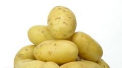 Potatoes fresh turning on white background Stock Footage