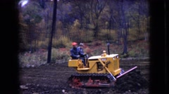 1966: modern day settlers clearing the way. OHIO Stock Footage