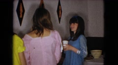 1966: girls standing holding cup drinking eating lady taking food talking OHIO Stock Footage