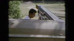 1966: a handsome young man sitting in a convertible with the top down OHIO Stock Footage