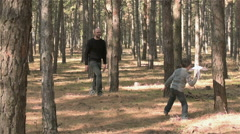 Sun launching paper plane into sky and his father jumps to catch it Stock Footage