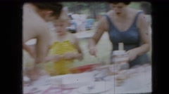 1966: picnickers in bathing suits setting up a pavilion table  Stock Footage