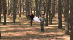 Happy father catches his son with paper airplane Stock Footage