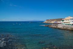 Small village La Caleta in south of Tenerife island. This village attracts a Stock Photos