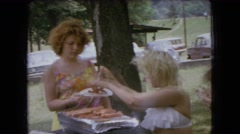 1966: barbecue party hot dogs people eating OHIO Stock Footage