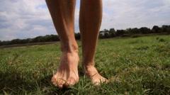 Legs, feet running on the grass,running barefoot Stock Footage