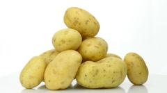 Mountain of potatoes fresh turning on white background Stock Footage