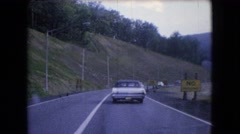 1966: a highway passing through a tunnel where many vehicles running  Stock Footage