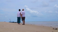 Asian senior couple beach. Well plan retired lifestyle no financial problem Arkistovideo