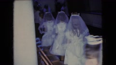 1966: photographs being taken of the little girls for holy communion. OHIO Stock Footage