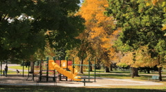 Kids outdoor playground in City Park. Stock Footage