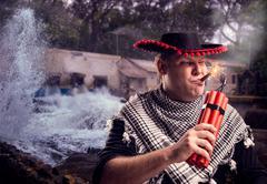 Man firing dynamite Kuvituskuvat