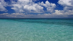 UHD shot of turquoise waters of the tropical sea and deep blue cloudy sky Stock Footage