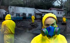 Woman in protective suit Stock Photos