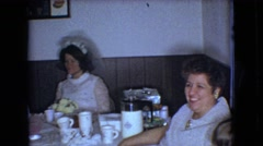 1966: waiting in line for their first bite of the wedding cake  Stock Footage