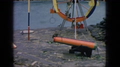 1966: monkeys at the zoo playing on a ferris wheel jungle gym and trapeze rings Stock Footage
