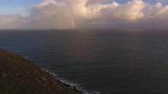 Aerial view from Bossington cliffs with a rainbow out at sea. Stock Footage