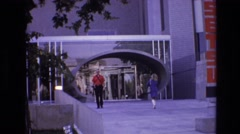 1974: people walking to and fro from a public building. DENVER COLORADO Stock Footage