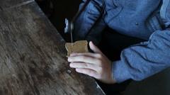 Little handsaw sawing wood veneer Stock Footage