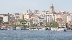 View of Istanbul with the Galata Tower, the Golden Horn and tourist boats Stock Footage