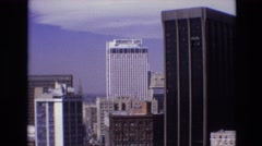 1974: tall buildings skyscrapers beautiful view cars moving road greenery DENVER Stock Footage