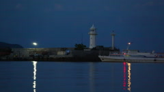 Flashing Beacon and the ship sailed in the waters of the night Yalta Stock Footage
