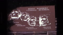 1974: sign in with white paint of mount rushmore national memorial SOUTH DAKOTA Stock Footage