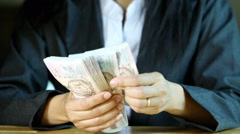Business woman count one thousand baht bill note in hand. Stock Footage