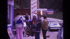 1974: man in american indian headdress being photographed with little boy Stock Footage