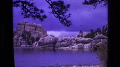 1974: scenic place with blue sparkling lake in the lap of mountain SOUTH DAKOTA Stock Footage