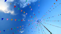 Party flags in wind, clear blue sky background. Stock Footage