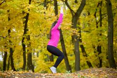 Yoga outdoors: Chair posture Stock Photos