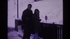 1974: couple waving at the camera on a snowy bridge. VAIL COLORADO Stock Footage