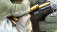 Soldier reload cartridges for weapons Stock Footage