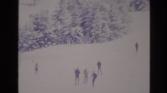 1974: people ski down snow covered mountain VAIL COLORADO Stock Footage