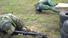 Soldier shooting with automatic gun Stock Footage