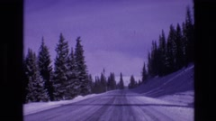 1974: driving on a snow packed road in winter at a safe speed for wintry Stock Footage