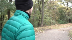 Man Afraid and Run Away in the Forest Stock Footage