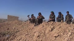 Syria - February 2016: Soldiers patrol in the desert, ISIS war, SDF (YPJ,YPG) Stock Footage