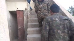 Syria - February 2016: Soldiers go upstairs to the roof, ISIS war, SDF (YPJ,YPG) Stock Footage