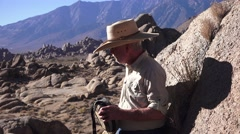 Alabama Hills, cowboy Western drinking from canteen Arkistovideo