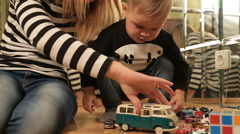 Beautiful Mother Playing With Her Son And Son Throws Toys Stock Footage
