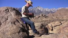Western man rugged boulders Stock Footage