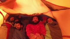 POV selfie portrait of four men sleeping in a tent. Stock Footage