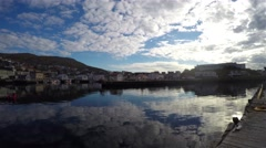 Moving time-lapse of the harbor full of boats, at the city of Honningsvag, in Stock Footage